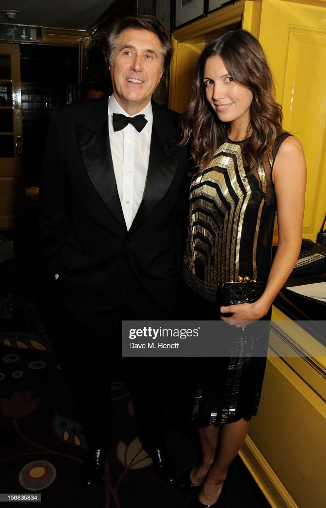 Bryan Ferry (L) and Amanda Sheppard attend a launch hosted by The Vinyl Factory of Bryan Ferry's new album 'The Jazz Age' at Annabelson November 22, 2012 in London, England.