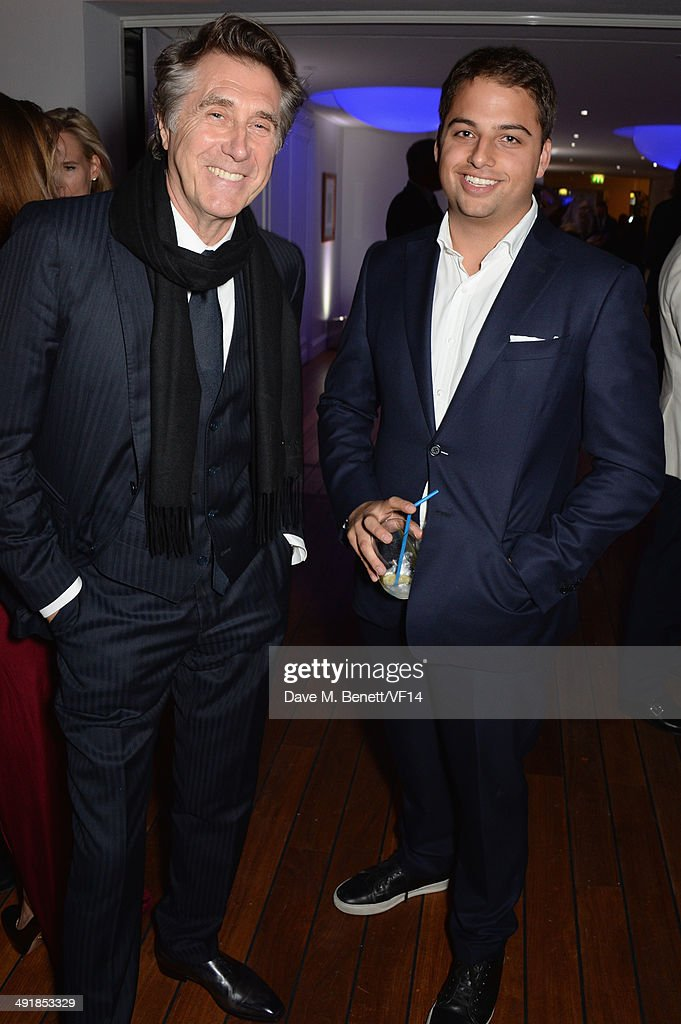 Bryan Ferry and Jamie Reuben attend the Vanity Fair And Armani Party at the 67th Annual Cannes Film Festival on May 17 2014 in Cap d'Antibes France