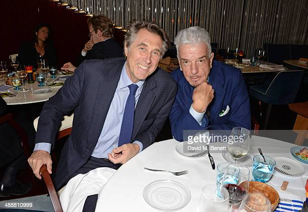 Bryan Ferry and Nicky Haslam attend the launch of Alain Ducasse's Rivea restaurant at The Bulgari Hotel on May 8 2014 in London England