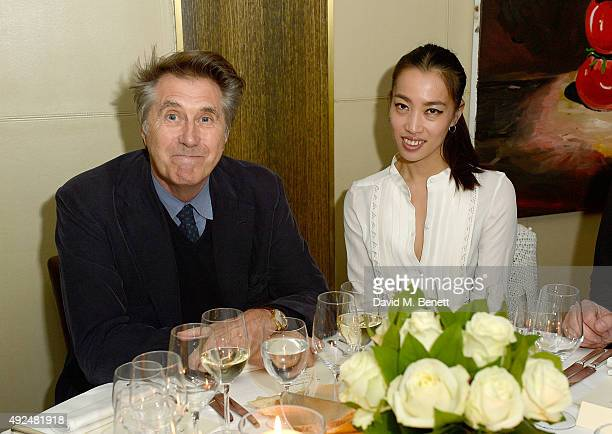 Bryan Ferry and Yi Zhou attend the Deconstructed Project with a private dinner hosted by Caroline Issa David Shrigley and Massimo Nicosia on October...