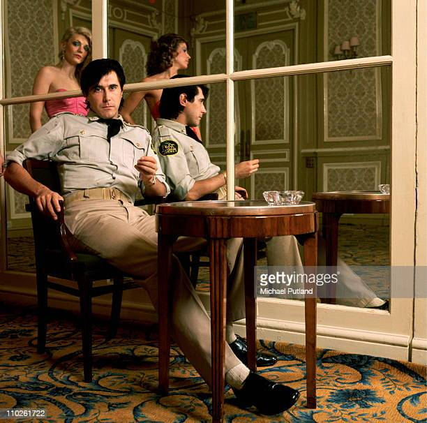 Bryan Ferry of Roxy Music portrait wearing military style uniform at the Montcalm Hotel London 31st October 1975 Reflected in the mirror are backing...