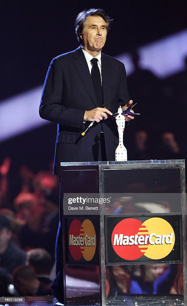 Bryan Ferry presents on stage at the Brit Awards at 02 Arena on February 20, 2013 in London, England.