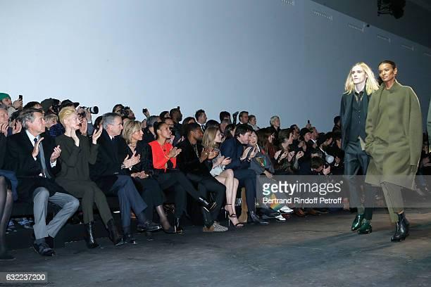 Bryan Ferry Tilda Swinton Owner of LVMH Luxury Group Bernard Arnault his wife Helene Arnault Usher his wife Grace Miguel Natalia Vodianova General...