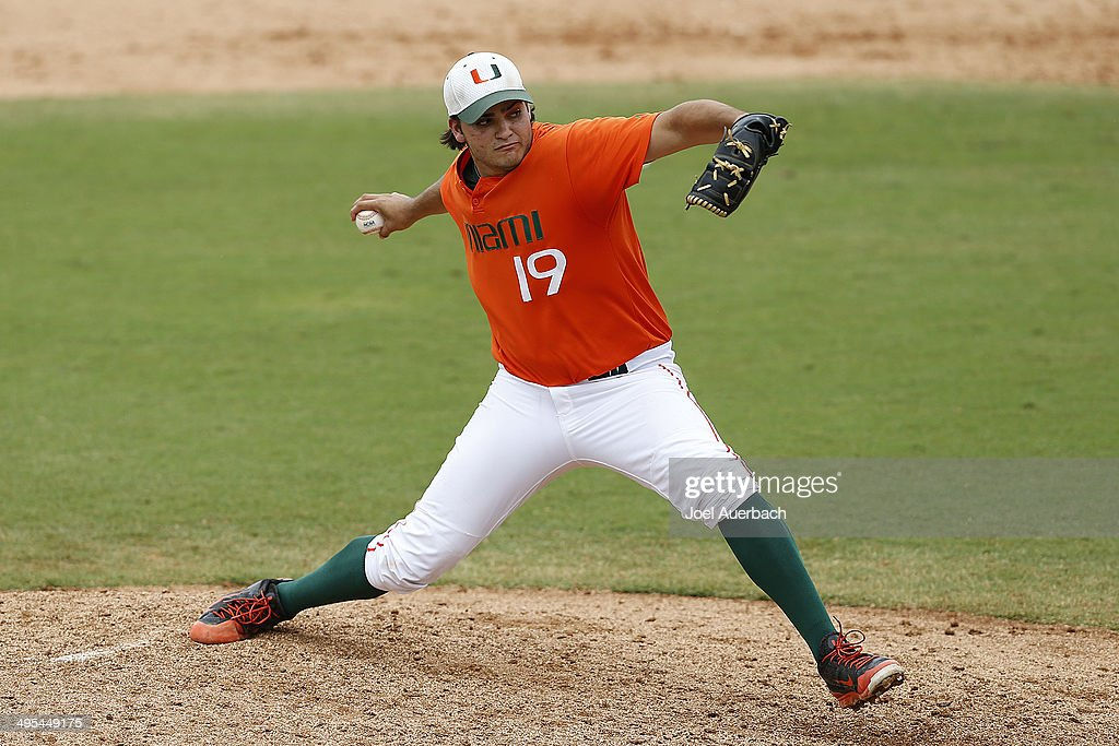 Bryan Garcia of the Miami Hurricanes throws the ball against the Texas Tech Red Raiders in the tenth inning during the Coral Gables Regional at the...