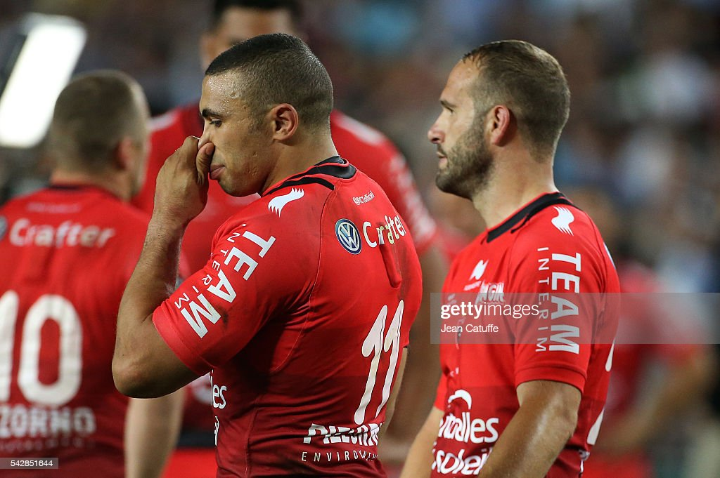 <a gi-track='captionPersonalityLinkClicked' href=/galleries/search?phrase=Bryan+Habana&family=editorial&specificpeople=221391 ng-click='$event.stopPropagation()'>Bryan Habana</a> and <a gi-track='captionPersonalityLinkClicked' href=/galleries/search?phrase=Frederic+Michalak&family=editorial&specificpeople=209294 ng-click='$event.stopPropagation()'>Frederic Michalak</a> of RC Toulon react following the Final Top 14 between Toulon and Racing 92 at Camp Nou on June 24, 2016 in Barcelona, Spain.