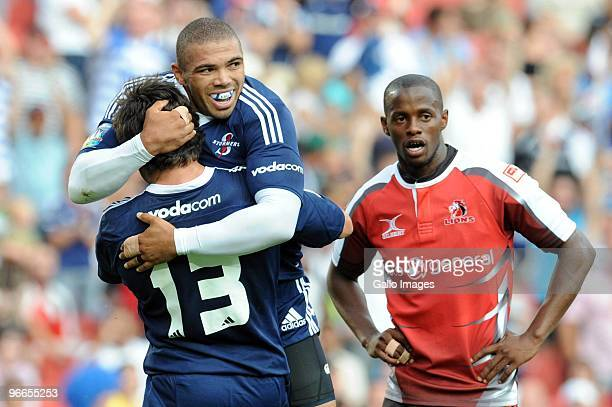 Bryan Habana and Jaque Fourie of Stormers celebrates a try while Wandile Mjekevu of Lions looks on during the Super 14 match between Auto and General...