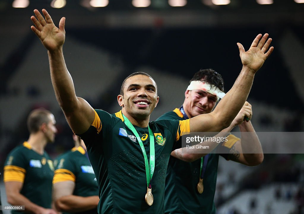 <a gi-track='captionPersonalityLinkClicked' href=/galleries/search?phrase=Bryan+Habana&family=editorial&specificpeople=221391 ng-click='$event.stopPropagation()'>Bryan Habana</a> of South Africa and team mates salute the crowd after victory in the 2015 Rugby World Cup Bronze Final match between South Africa and Argentina at the Olympic Stadium on October 30, 2015 in London, United Kingdom.