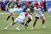 Bryan Habana of South Africa carries the ball against Folau Niua and Martin Iosefo of the United States during the USA Sevens Rugby tournament at Sam...