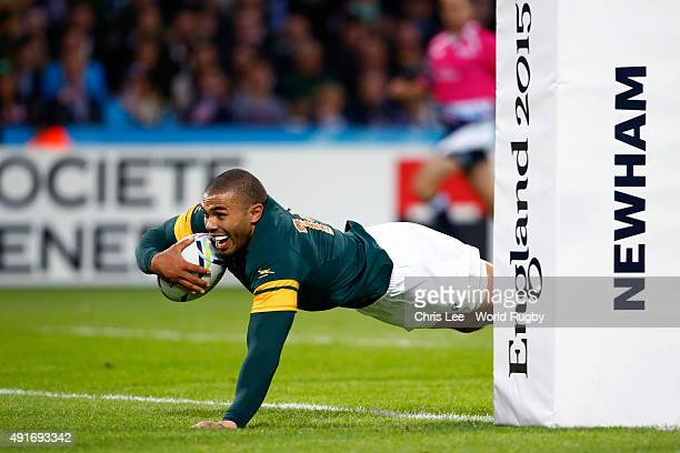 Bryan Habana of South Africa goes over to score his second try and South Africa's sixth during the 2015 Rugby World Cup Pool B match between South...