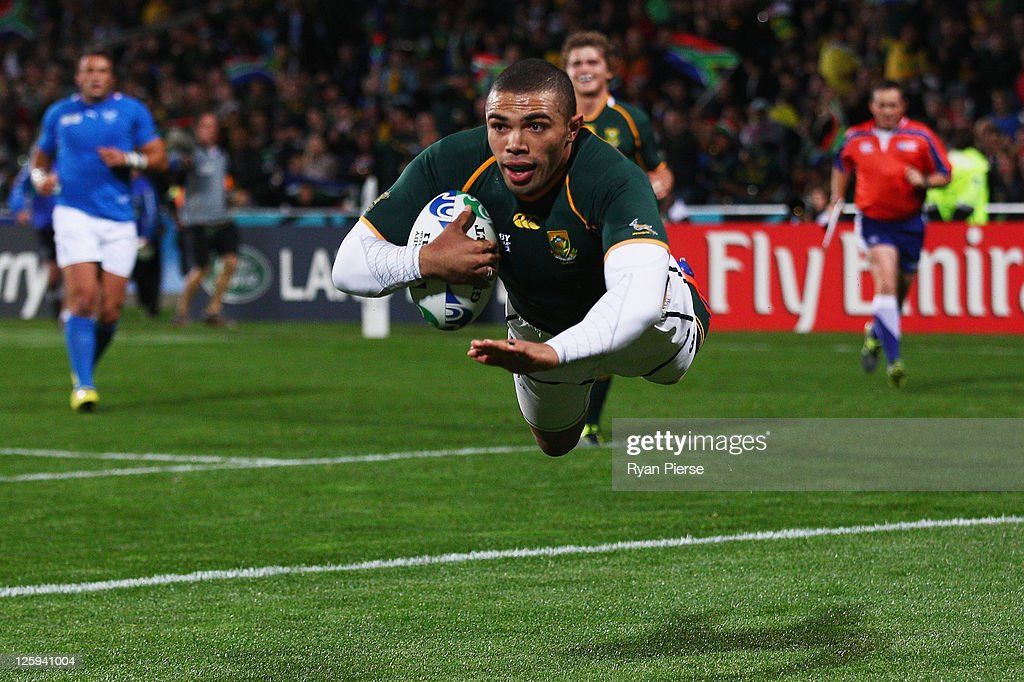 <a gi-track='captionPersonalityLinkClicked' href=/galleries/search?phrase=Bryan+Habana&family=editorial&specificpeople=221391 ng-click='$event.stopPropagation()'>Bryan Habana</a> of South Africa goes over to score their second try during the IRB 2011 Rugby World Cup Pool B match between South Africa and Namibia at North Harbour Stadium on September 22, 2011 in Auckland, New Zealand.