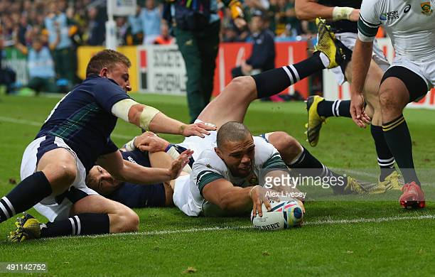 Bryan Habana of South Africa goes over to score their third try during the 2015 Rugby World Cup Pool B match between South Africa and Scotland at St...