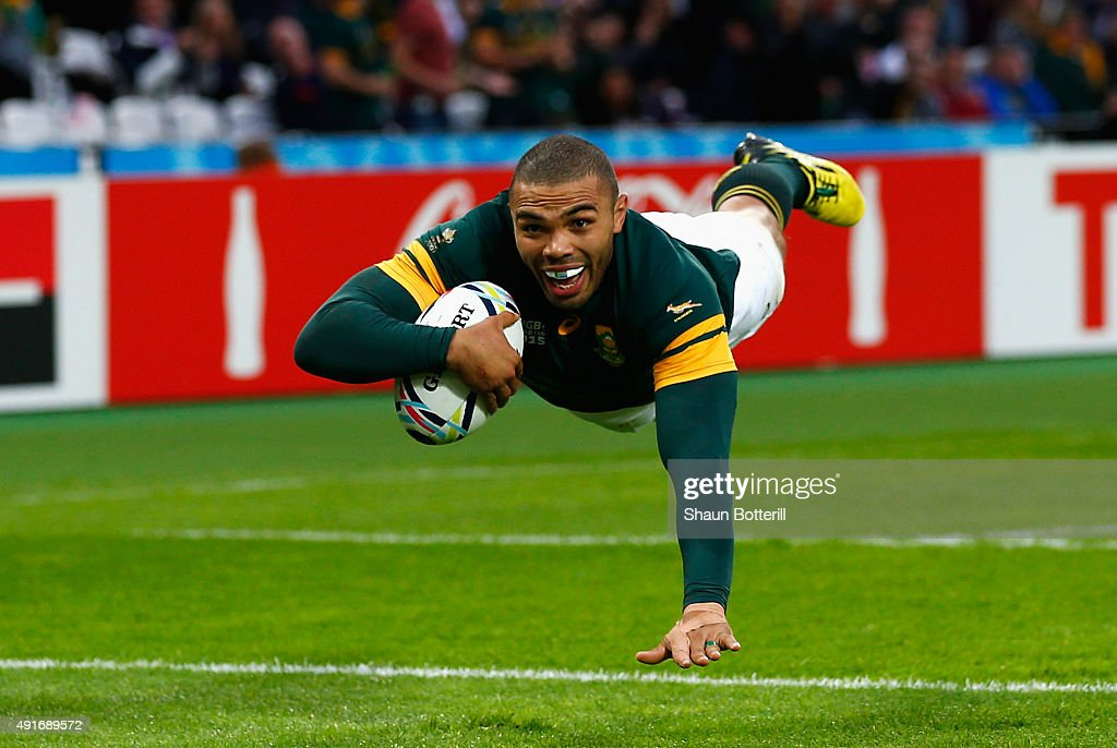<a gi-track='captionPersonalityLinkClicked' href=/galleries/search?phrase=Bryan+Habana&family=editorial&specificpeople=221391 ng-click='$event.stopPropagation()'>Bryan Habana</a> of South Africa goes over to score their third try during the 2015 Rugby World Cup Pool B match between South Africa and USA at the Olympic Stadium on October 7, 2015 in London, United Kingdom.