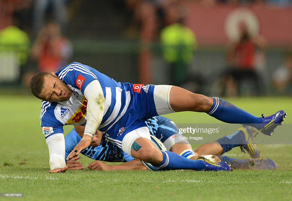 <a gi-track='captionPersonalityLinkClicked' href=/galleries/search?phrase=Bryan+Habana&family=editorial&specificpeople=221391 ng-click='$event.stopPropagation()'>Bryan Habana</a> of the Stormers gets tackled during the Super Rugby match between Vodacom Bulls and DHL Stormers from Loftus Versfeld Stadium on February 22, 2013 in Pretoria, South Africa.