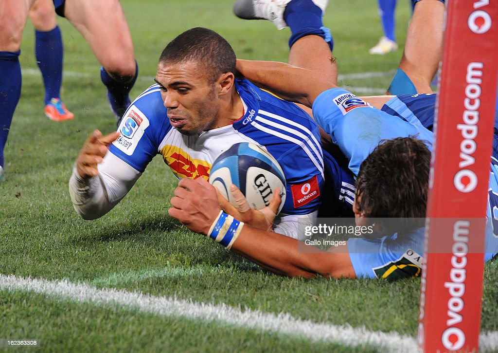 <a gi-track='captionPersonalityLinkClicked' href=/galleries/search?phrase=Bryan+Habana&family=editorial&specificpeople=221391 ng-click='$event.stopPropagation()'>Bryan Habana</a> of the Stormers goes over for his try during the Super Rugby match between Vodacom Bulls and DHL Stormers from Loftus Versfeld Stadium on February 22, 2013 in Pretoria, South Africa.