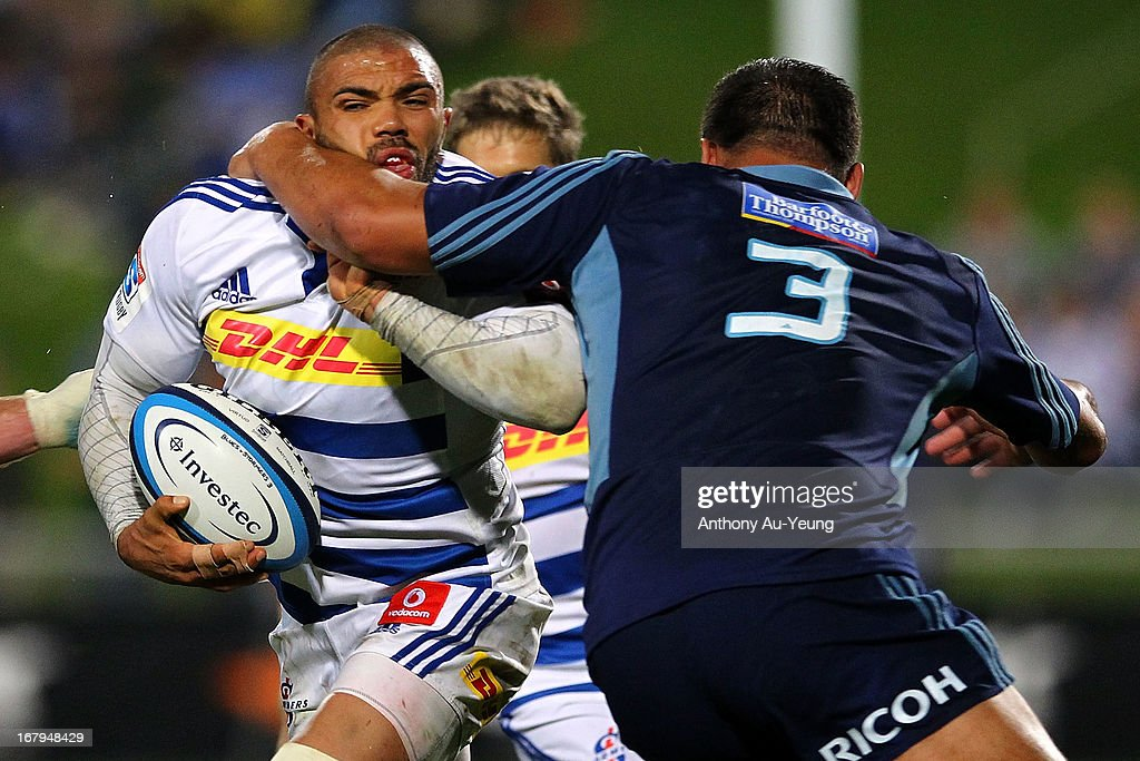 <a gi-track='captionPersonalityLinkClicked' href=/galleries/search?phrase=Bryan+Habana&family=editorial&specificpeople=221391 ng-click='$event.stopPropagation()'>Bryan Habana</a> of the Stormers is tackled high by Angus Ta'avao of the Blues during the round 12 Super Rugby match between the Blues and the Stormers at North Harbour Stadium on May 3, 2013 in Auckland, New Zealand.