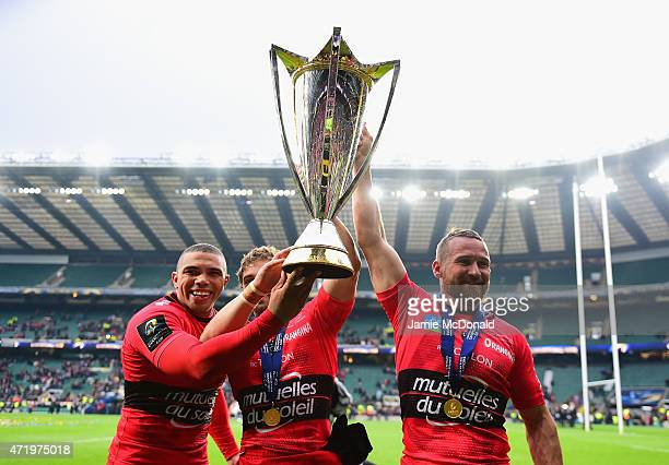 Bryan Habana of Toulon Leigh Halfpenny of Toulon and Matt Giteau of Toulon celebrate with the trophy during the European Rugby Champions Cup Final...
