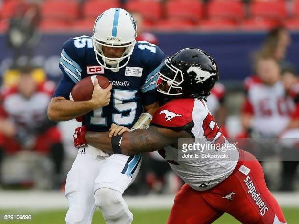 Bryan Hall of the Calgary Stampeders sacks Ricky Ray of the Toronto Argonauts during a CFL game at BMO Field on August 3 2017 in Toronto Ontario...