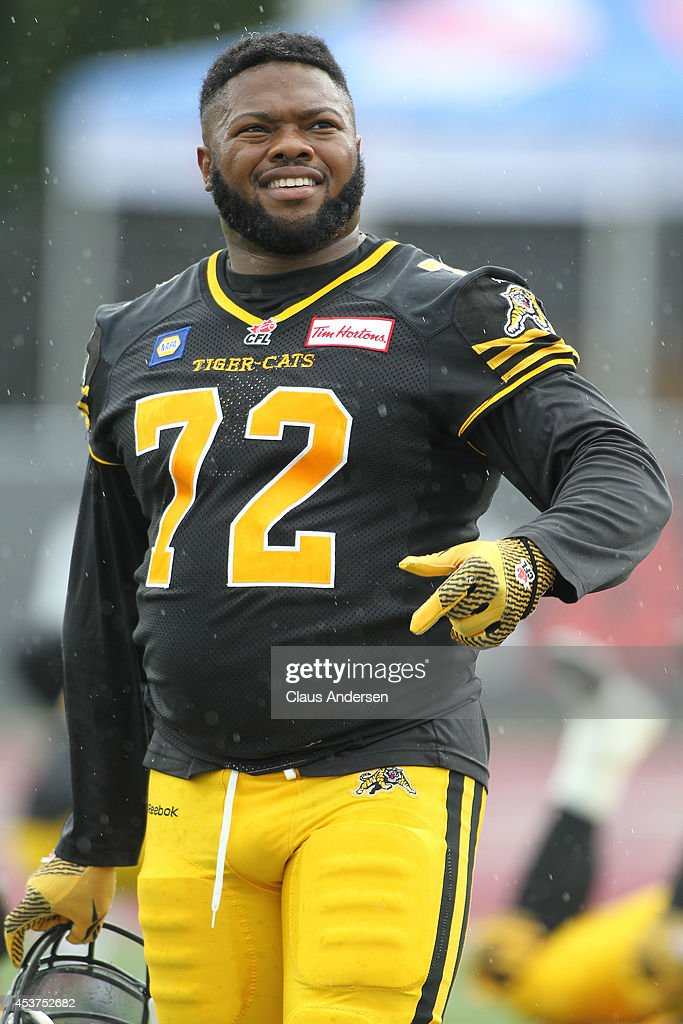 Bryan Hall of the Hamilton TigerCats gets set to play against the Calgary Stampeders in a CFL game at Ron Joyce Stadium on August 16 2014 in Hamilton...