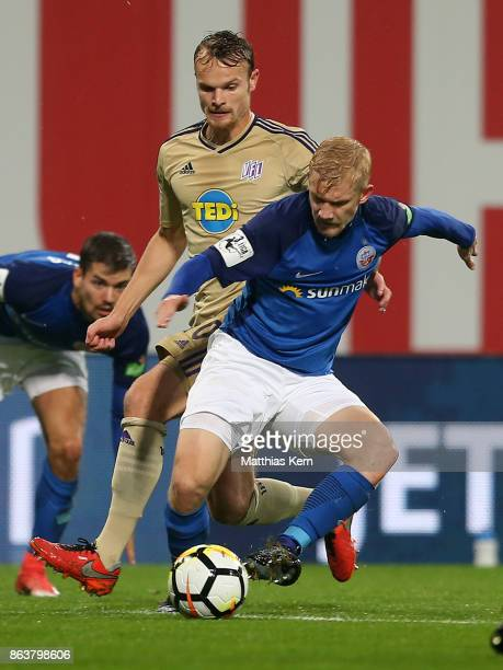 Bryan Henning of Rostock battles for the ball with Christian Gross of Osnabrueck during the third league match between FC Hansa Rostock and VfL...