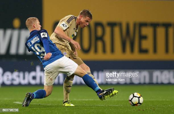 Bryan Henning of Rostock battles for the ball with Steffen Tigges of Osnabrueck during the third league match between FC Hansa Rostock and VfL...