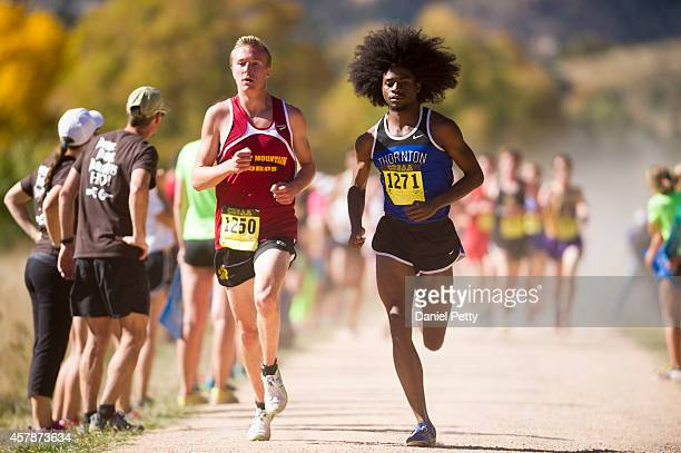 Bryan Hird of Rocky Mountain and Joshua Joseph of Thornton compete in the Boys Class 5A Colorado state cross country championships at NorrisPenrose...