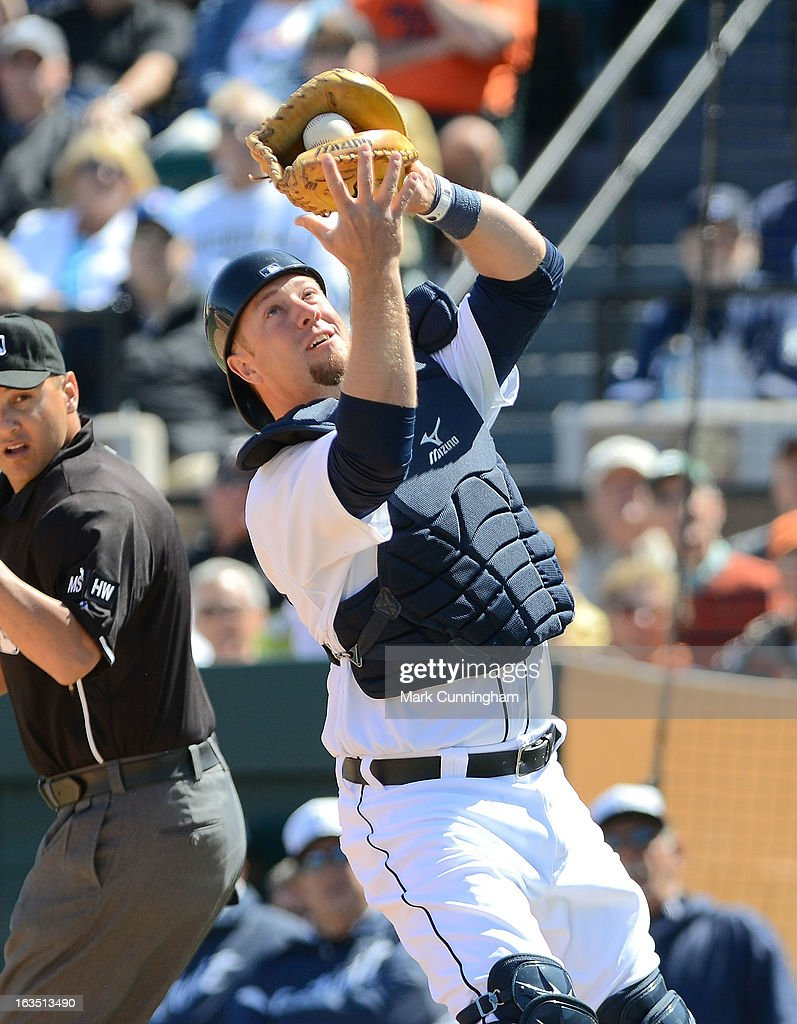 Bryan Holaday #50 of the Detroit Tigers catches a baseball during the spring training game against the Toronto Blue Jays at Joker Marchant Stadium on March 6, 2013 in Lakeland, Florida. The Tigers defeated the Blue Jays 4-1.