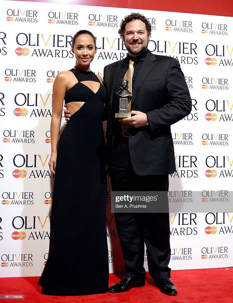 Bryan Hymel with his Outstanding Achievement in Opera award and presenter <a gi-track='captionPersonalityLinkClicked' href=/galleries/search?phrase=Myleene+Klass&family=editorial&specificpeople=201597 ng-click='$event.stopPropagation()'>Myleene Klass</a> during The Laurence Olivier Awards at the Royal Opera House on April 28, 2013 in London, England.