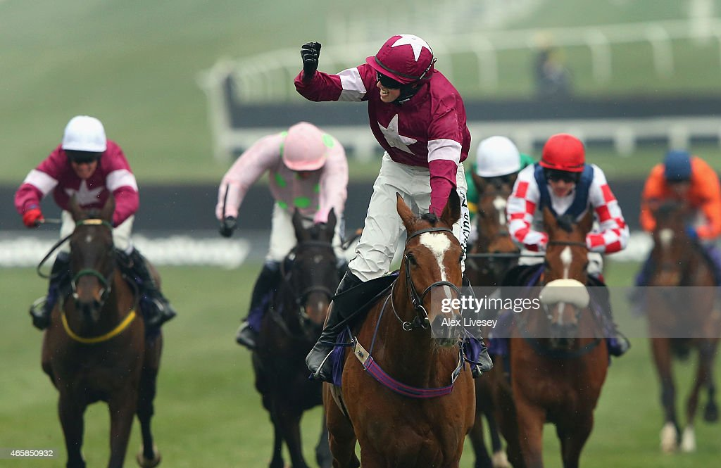 Bryan J Cooper celebrates on Don Poli as they win the RSA Chase during Ladies Day at the Cheltenham Festival at Cheltenham Racecourse on March 11...