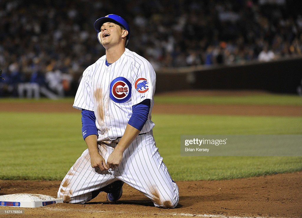 Bryan LaHair #6 of the Chicago Cubs reacts after he was picked off of first base during the seventh inning against the New York Mets at Wrigley Field on June 26, 2012 in Chicago, Illinois.
