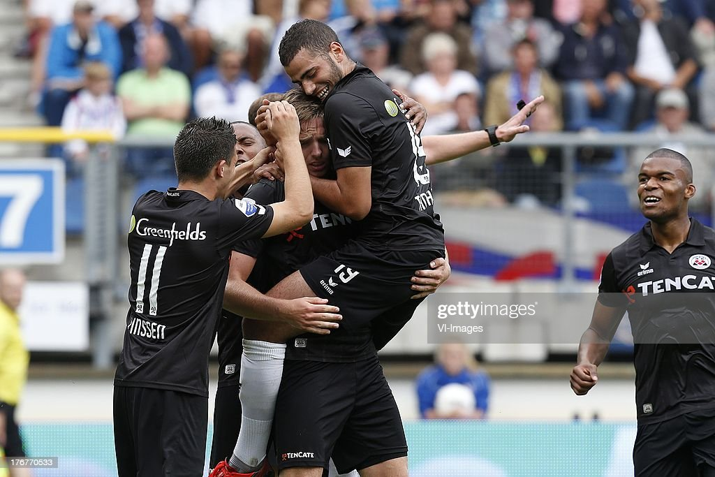 Bryan Linssen of Heracles Almelo (L), Ben Rienstra of Heracles Almelo (CL), Oussama Tannane (CR) during the Dutch Eredivisie match between sc Heerenveen and Heracles Almelo on August 18, 2013 at the Abe Lenstra stadium in Heerenveen, The Netherlands.