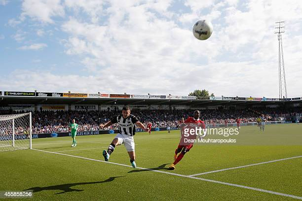 Bryan Linssen of Heraclesclears the ball away from Cuco Martina of Twente during the Dutch Eredivisie match between Heracles Almelo and FC Twente at...