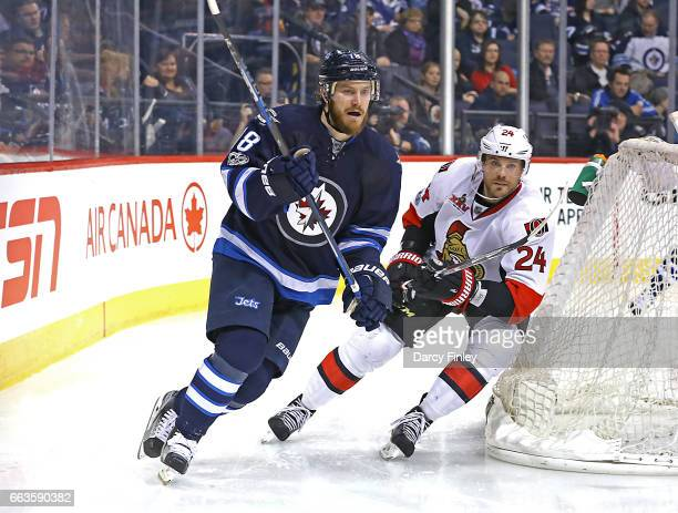 Bryan Little of the Winnipeg Jets and Viktor Stalberg of the Ottawa Senators follow the play around the net during third period action at the MTS...