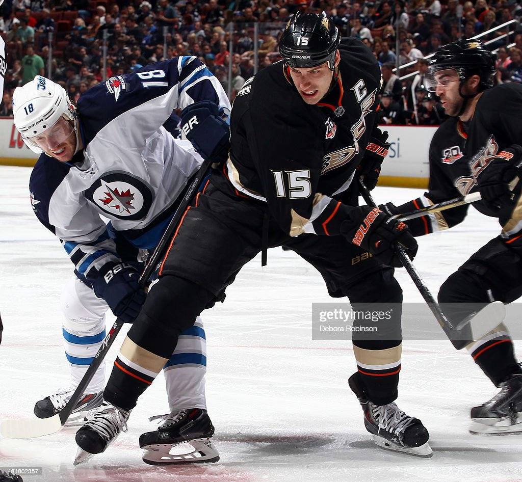 Bryan Little #18 of the Winnipeg Jets battles for position against Ryan Getzlaf #15 of the Anaheim Ducks on March 31, 2014 at Honda Center in Anaheim, California.