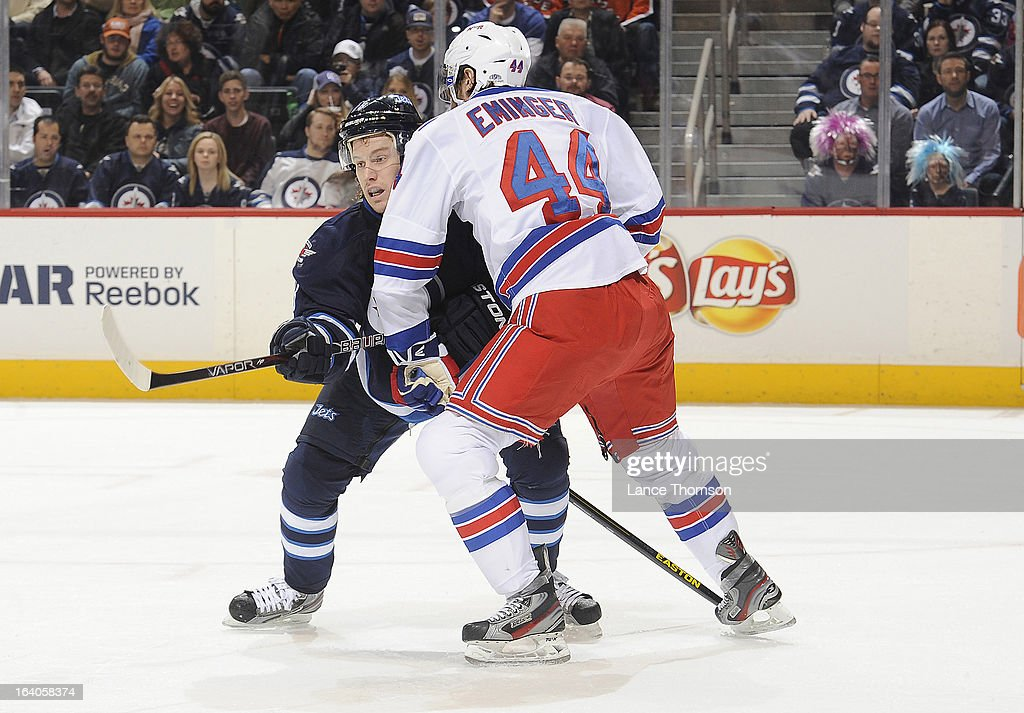 Bryan Little #18 of the Winnipeg Jets battles for position against Steve Eminger #44 of the New York Rangers during first period action at the MTS Centre on March 14, 2013 in Winnipeg, Manitoba, Canada. The Jets defeated the Rangers 3-1.
