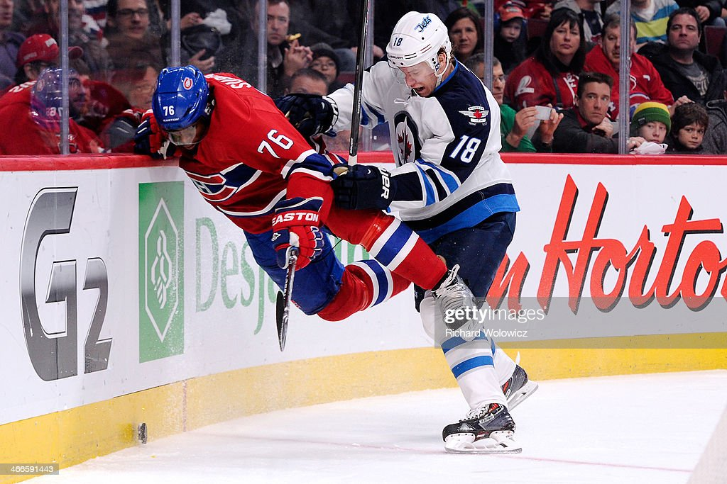 <a gi-track='captionPersonalityLinkClicked' href=/galleries/search?phrase=Bryan+Little&family=editorial&specificpeople=540533 ng-click='$event.stopPropagation()'>Bryan Little</a> #18 of the Winnipeg Jets body checks <a gi-track='captionPersonalityLinkClicked' href=/galleries/search?phrase=P.K.+Subban&family=editorial&specificpeople=714418 ng-click='$event.stopPropagation()'>P.K. Subban</a> #76 of the Montreal Canadiens during the NHL game at the Bell Centre on February 2, 2014 in Montreal, Quebec, Canada.