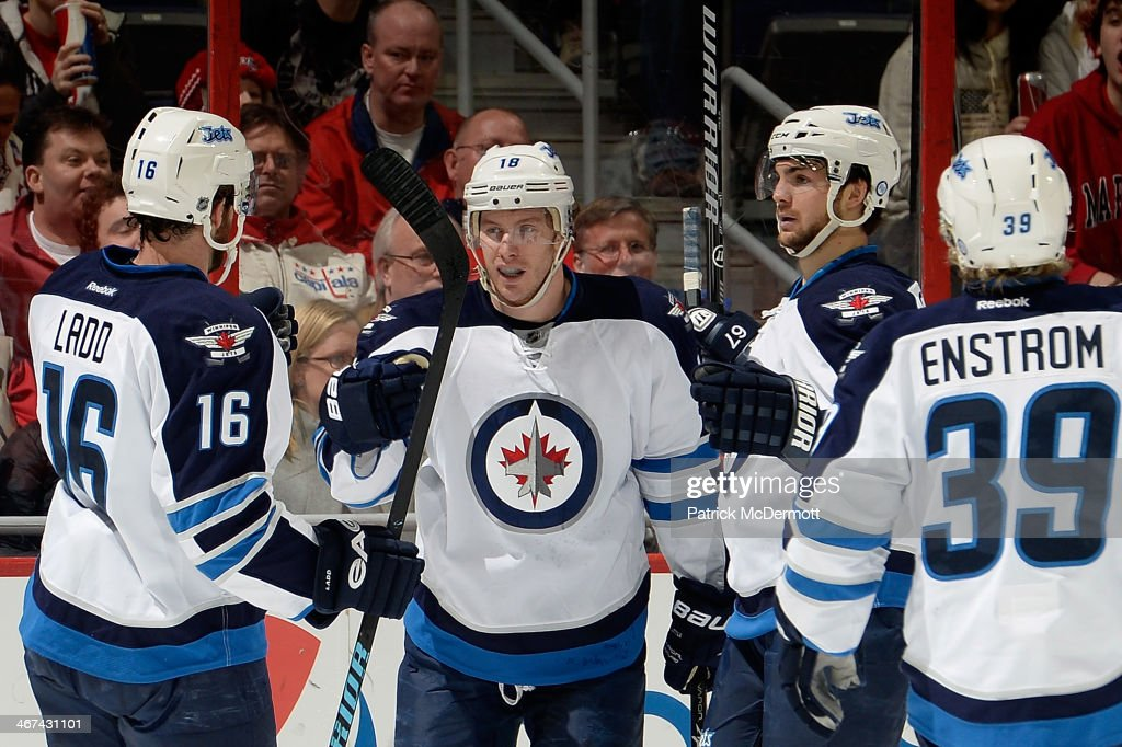 <a gi-track='captionPersonalityLinkClicked' href=/galleries/search?phrase=Bryan+Little&family=editorial&specificpeople=540533 ng-click='$event.stopPropagation()'>Bryan Little</a> #18 of the Winnipeg Jets celebrates after scoring a goal in the first period during an NHL game against the Washington Capitals at Verizon Center on February 6, 2014 in Washington, DC.
