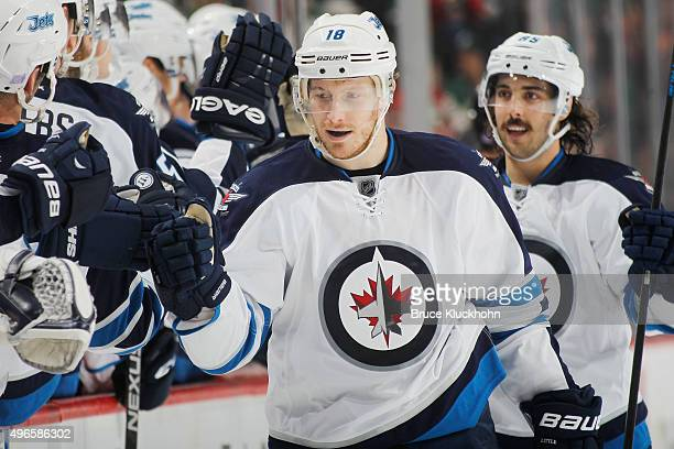 Bryan Little of the Winnipeg Jets celebrates after scoring a goal against the Minnesota Wild during the game on November 10 2015 at the Xcel Energy...