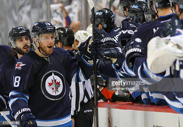Bryan Little of the Winnipeg Jets celebrates his first period goal against the Anaheim Ducks with teammates at the bench in Game Four of the Western...