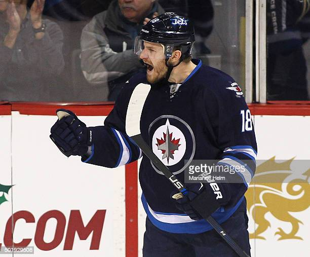 Bryan Little of the Winnipeg Jets celebrates his goal in first period action in an NHL game against the New York Rangers at the MTS Centre on...