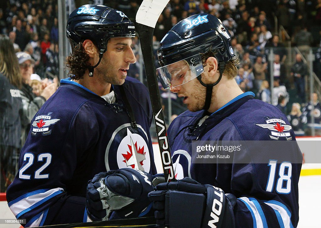 <a gi-track='captionPersonalityLinkClicked' href=/galleries/search?phrase=Bryan+Little&family=editorial&specificpeople=540533 ng-click='$event.stopPropagation()'>Bryan Little</a> #18 of the Winnipeg Jets celebrates with teammate <a gi-track='captionPersonalityLinkClicked' href=/galleries/search?phrase=Chris+Thorburn&family=editorial&specificpeople=2222066 ng-click='$event.stopPropagation()'>Chris Thorburn</a> #22 as he leaves the ice following a 7-2 victory over the Florida Panthers at the MTS Centre on April 11, 2013 in Winnipeg, Manitoba, Canada.