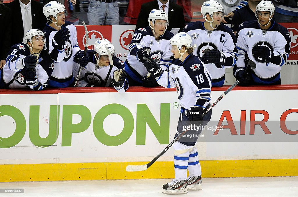 <a gi-track='captionPersonalityLinkClicked' href=/galleries/search?phrase=Bryan+Little&family=editorial&specificpeople=540533 ng-click='$event.stopPropagation()'>Bryan Little</a> #18 of the Winnipeg Jets celebrates with teammates after scoring during the shootout against the Washington Capitals at the Verizon Center on February 9, 2012 in Washington, DC. Winnipeg won the game 3-2 in a shootout.