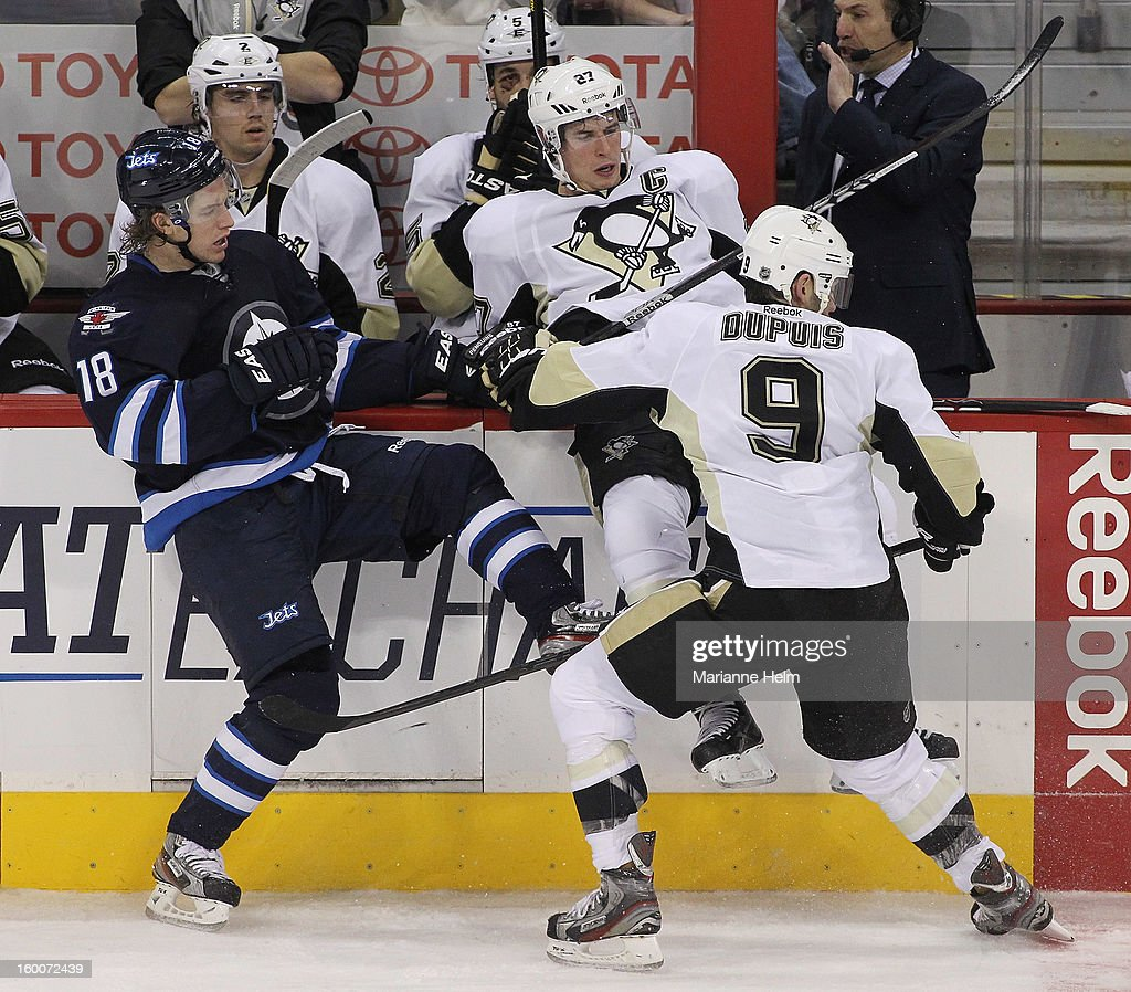 Bryan Little #18 of the Winnipeg Jets collides with Sidney Crosby #87 of the Pittsburgh Penguins during second-period action on January 25, 2013 at the MTS Centre in Winnipeg, Manitoba, Canada.