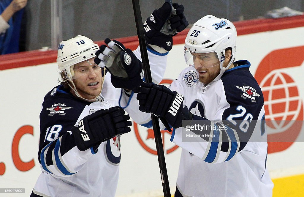 Bryan Little #18 of the Winnipeg Jets congratulates <a gi-track='captionPersonalityLinkClicked' href=/galleries/search?phrase=Blake+Wheeler&family=editorial&specificpeople=716703 ng-click='$event.stopPropagation()'>Blake Wheeler</a> #26 for his goal against the Anaheim Ducks in NHL action at the MTS Centre on December 17, 2011 in Winnipeg, Manitoba, Canada.
