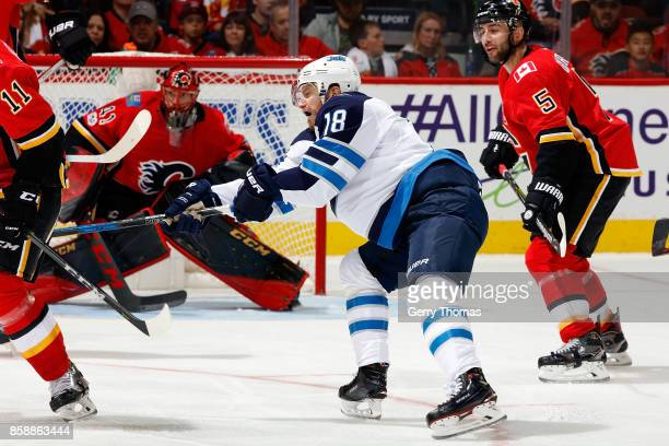 Bryan Little of the Winnipeg Jets during an NHL game on October 7 2017 at the Scotiabank Saddledome in Calgary Alberta Canada