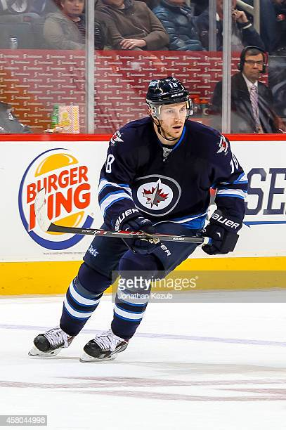 Bryan Little of the Winnipeg Jets follows the play down the ice during first period action against the Carolina Hurricanes on October 21 2014 at the...