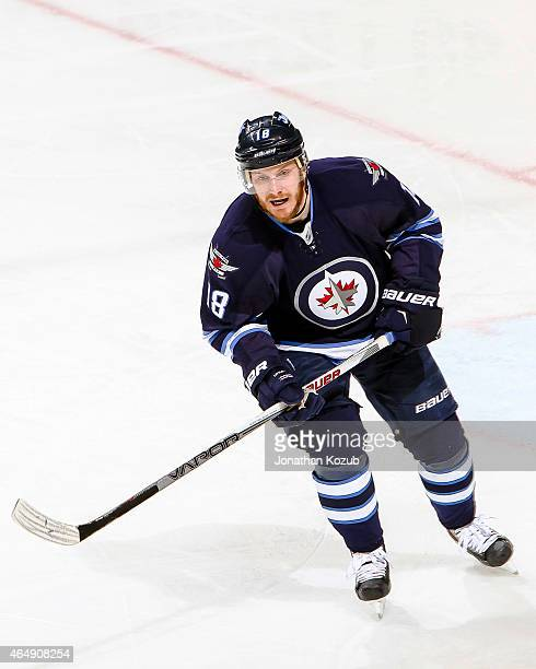 Bryan Little of the Winnipeg Jets follows the play down the ice during second period action against the Dallas Stars on February 24 2015 at the MTS...