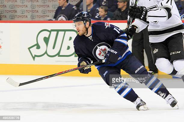 Bryan Little of the Winnipeg Jets follows the play down the ice during first period action against the Los Angeles Kings at the MTS Centre on October...