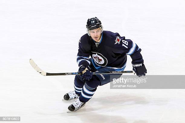Bryan Little of the Winnipeg Jets follows the play down the ice during third period action against the Arizona Coyotes at the MTS Centre on January...
