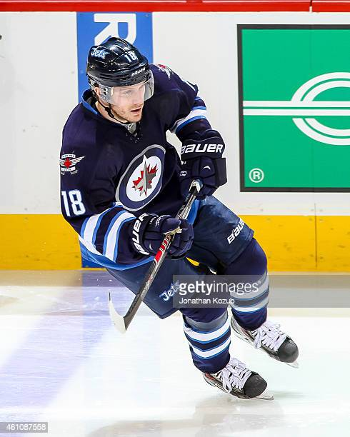 Bryan Little of the Winnipeg Jets follows the play up the ice during second period action against the Minnesota Wild on December 29 2014 at the MTS...