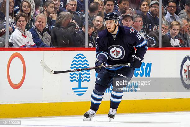 Bryan Little of the Winnipeg Jets follows the play up the ice during first period action against the St Louis Blues at the MTS Centre on October 18...